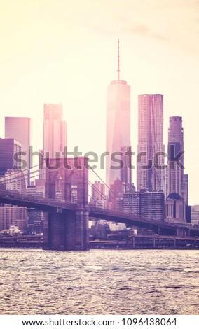 Retro toned picture of Manhattan skyline at sunset, New York City, USA.
