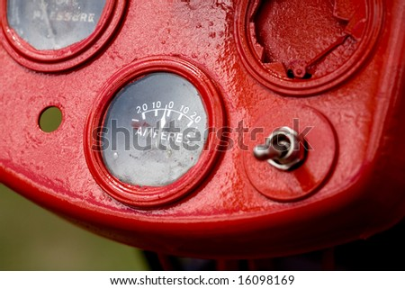 Retro tractor dials - focus on the amperes gauge