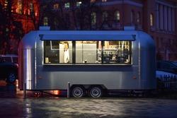 retro trailer of street food in night city