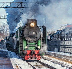 Retro train departs from the railway station. Moscow. Russia.