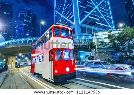 Retro tram on the evening city street. Hong Kong.