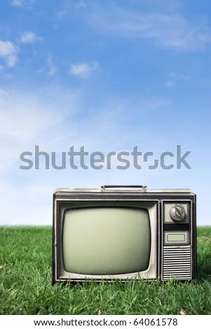 retro tv on grass - stock photo