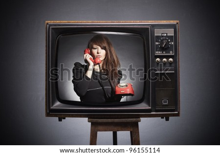 Retro TV on the screen says the young woman in a retro phone.