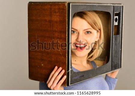 retro tv. retro tv with happy woman. smiling woman with retro tv on head. retro tv set. movie #1165628995
