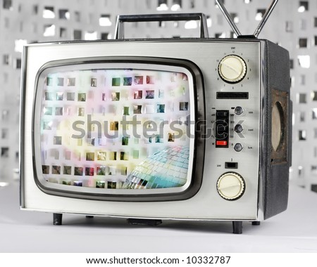 retro tv with sparkling discoball on screen