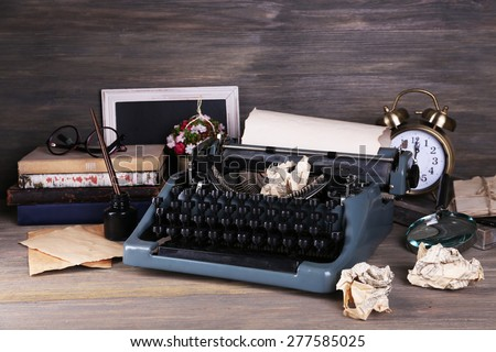 Retro typewriter on wooden background #277585025