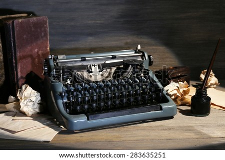 Retro typewriter on wooden background #283635251