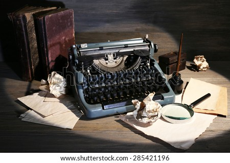 Retro typewriter on wooden background #285421196