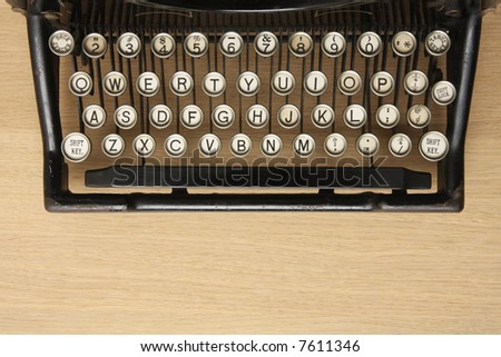 Retro typewriter with qwerty keyboard on a wooden desk - stock photoQwerty Keyboard Typewriter