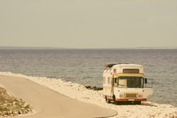 Retro van by the sea on the old vintage photo filter