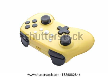 Retro video game gamepad. Yellow controller for a video game. Gamepad isolated on a white background. Full depth of field.
