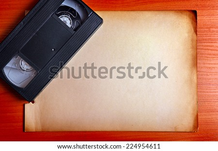 Retro Video Tape on the Board with the Empty Paper