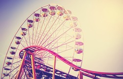 Retro vintage instagram stylized picture of an amusement park.