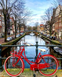 Retro vintage red bike. Bike along the Amsterdam canals