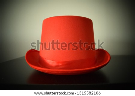 Retro vintage red top hat with ribbon and upturned rim