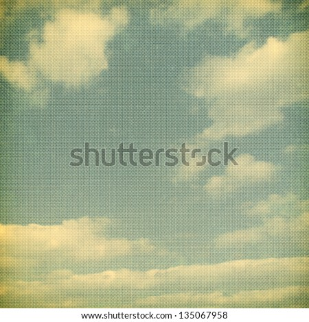 Retro vintage sky and clouds background/texture with vignette.