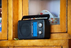 Retro vintage transistor radio of Indian and tibetan people in living room of house at Leh Ladakh village at Himalayan valley in Jammu and Kashmir, India while winter season