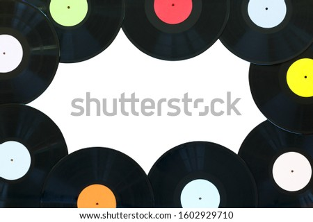 Retro vinyl discs records on white background. Multicolored labels. Isolated place to copy space. Top view. Horizontally framed shot.