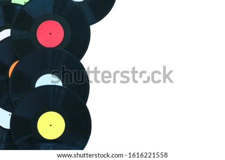 Retro vinyl discs records on white background. Multicolored labels. Top view. Isolated place to copy space. Horizontally framed shot.