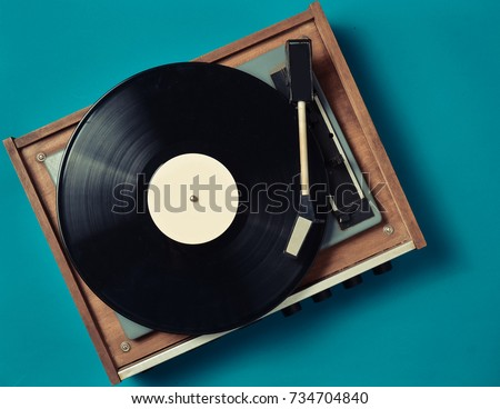 Retro vinyl player on a blue background. Entertainment 70s. Listen to music. Top view. #734704840