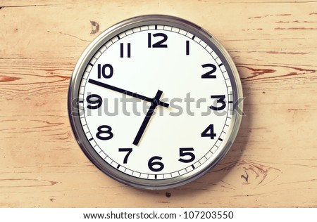 retro wall clock on old wooden background