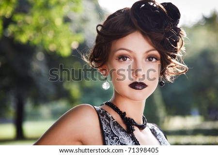 Retro Woman Portrait. Beautiful Woman. Vintage Styled Photo. Old Fashioned Makeup and Finger Wave Hairstyle. 20`s or 30`s style