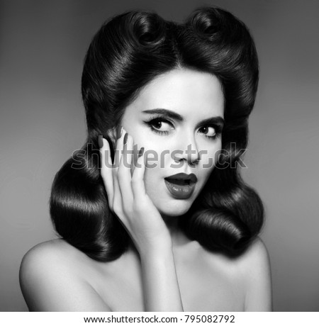 Retro woman portrait. Surprised and shocked 50s pin up girl with hairstyle vintage photo. Lady looking to the side.