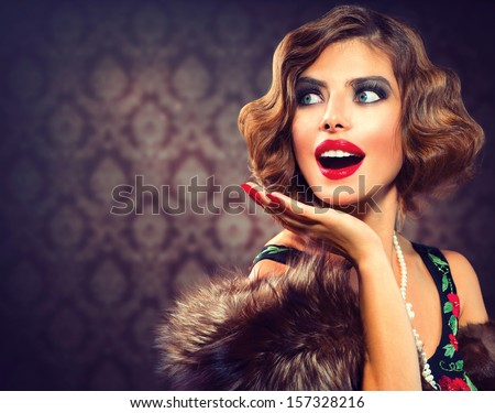 Vintage Styled Photo. Old Fashioned Makeup and Finger Wave Hairstyle