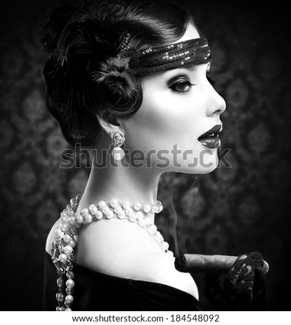 Retro Woman Portrait. Vintage Styled Girl With Cigar. Smoking Lady. Vintage Styled Black and White Photo. Old Fashioned Makeup and Finger Wave Hairstyle. 20\'s or 30\'s style.