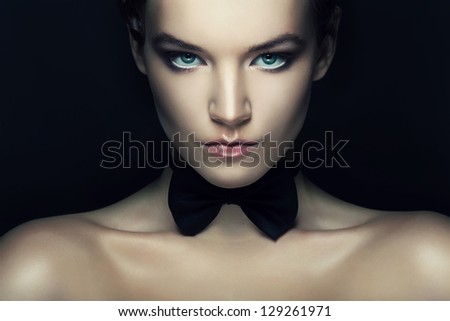 retro woman with black tie bow on neck