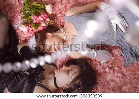 Retro women on bed in studio #396350539