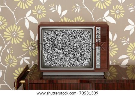 retro wooden tv on wooden vintage  furniture floral wallpaper [Photo Illustration]
