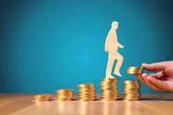 Return on investment, growing savings or wage income concept. Coins and wooden person going on increasing columns of coins. Helping hand adds more money. Successful investment concept.