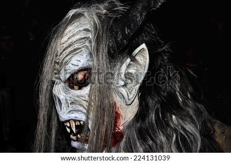 RETZ, AUSTRIA - DECEMBER 7: Unidentified man wears devil mask at traditional procession on December 7, 2013 in Retz, Austria.