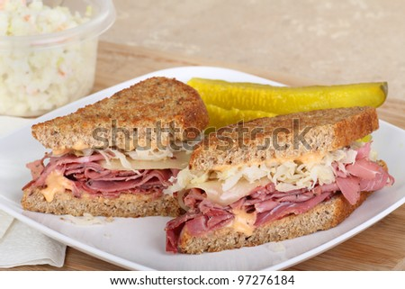 Reuben sandwich with pickles on a plate