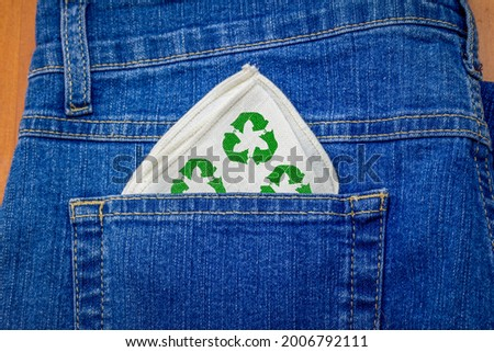 Reusable fabric hanky with recycle textiles icon in jeans back pocket, washable reusable handkerchief reduce consumption and waste Stock photo ©