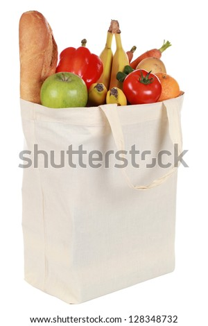 Reusable shopping bag filled with a bread, vegetables and fruits, isolated on white