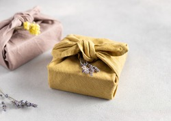 reusable sustainable gift wrapping in linen fabric. Furoshiki gifts. zero waste concept. close-up. selective focus
