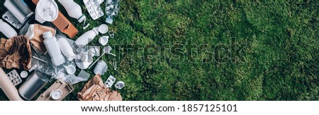 Reuse garbage, recycle, plastic free. Food plastic packaging, trash on green moss background after picnic in forest. Top view. Copy space. Recycling plastic. Environmental pollution, ecology concept Photo stock ©