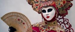 Reveller In Traditional Elaborate Mask And Costume At The Annual Venice Carnival (Carnevale di Venezia). Venice, Veneto, Italy, Europe