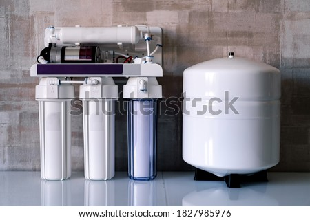Reverse osmosis water purification system at home. Installed water purification filters. Clear water concept Photo stock ©