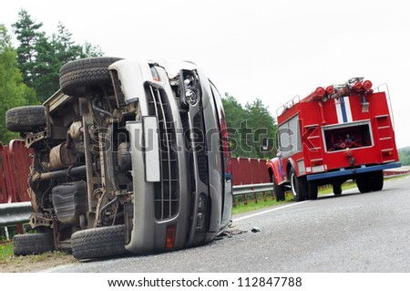 Reversed automobile car laying on country road after accident crash