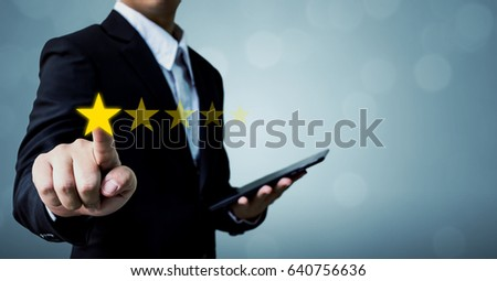 Review and rating increase company concept, Businessman hand touching five star