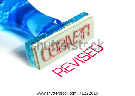 revised letter on blue rubber stamp isolated on white background