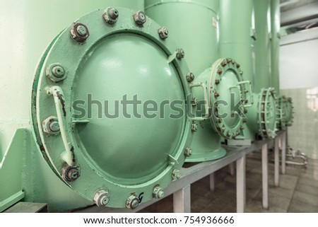 Revision hatch in the sand filter. Industrial filtering equipment. #754936666