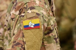 Revolutionary Armed Forces of Colombia flag on soldiers arm. Revolutionary Armed Forces of Colombia—People's Army (collage)