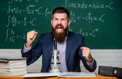 Revolutionary invention done. Happy scientist made invention. Bearded man celebrate invention in biology. New invention. Science research. School laboratory.