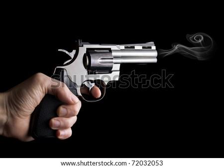 Revolver Gun in hand - stock photo