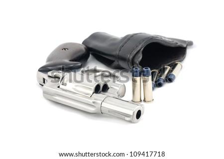 Revolver gun .38 mm and bullets  white background