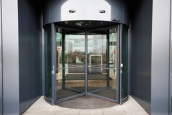 Revolving door in reception of office building.